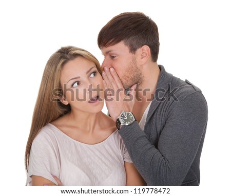 Loving guy whispered something naughty in wife's ear. - stock photo