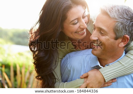 Loving Hispanic Couple In Countryside - stock photo