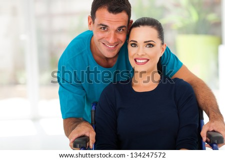 loving husband and disabled wife closeup portrait - stock photo