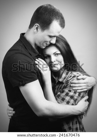 loving man and woman hugging each other