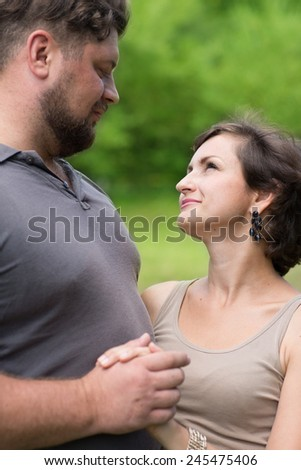 Loving man and woman looking at each other - stock photo