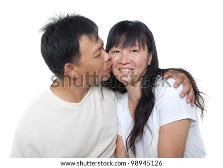 Loving Mature Asian couple kissing on white background - stock photo