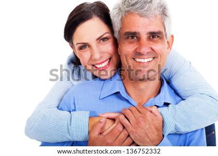 loving middle aged couple on white background - stock photo