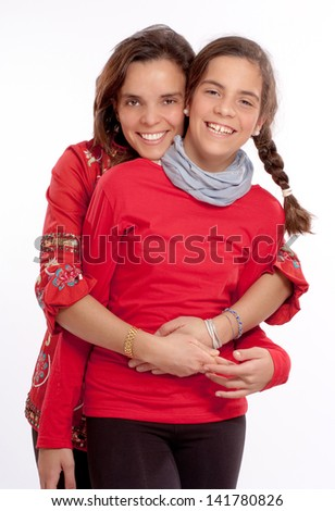 Loving mom and young daughter - stock photo