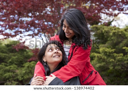 loving mother and daughter enjoying in park - stock photo