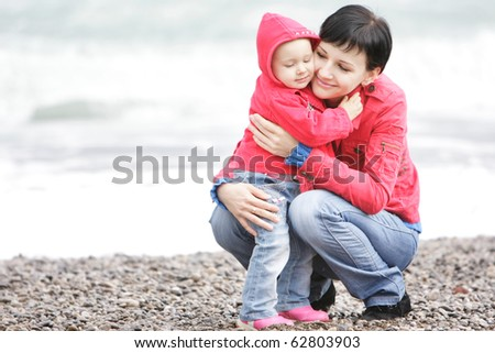 loving mother and daughter on beach - stock photo