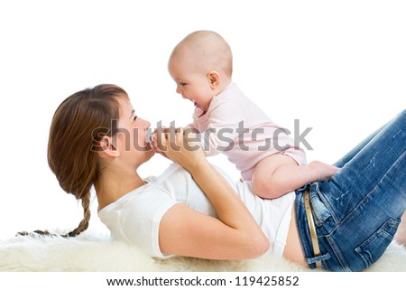 Loving mother having fun with her baby girl - stock photo