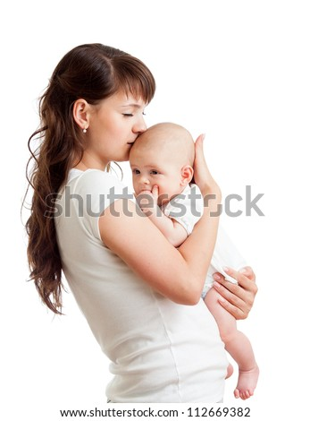 loving mother kissing her baby isolated on white background - stock photo