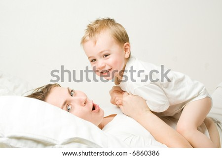 Loving mother playing with her toddler - stock photo