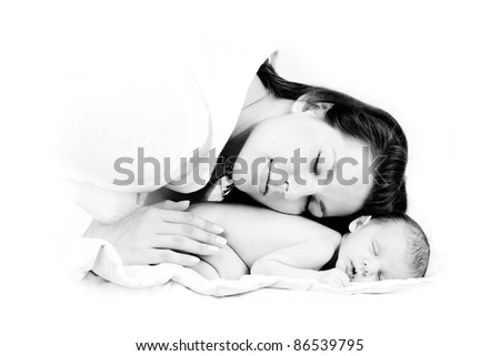 loving mother puts head on her sleeping newborn - stock photo