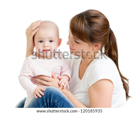 Loving mother with her baby girl on white background