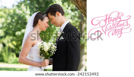 Loving newly wed couple in garden against happy valentines day - stock photo