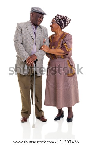 loving senior african couple looking one another over white background - stock photo