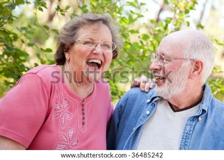 Loving Senior Couple Enjoying the Outdoors Together. - stock photo