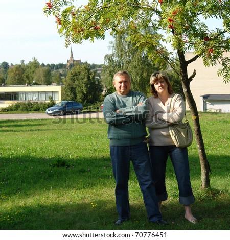 Loving Senior Couple Walking and Enjoying the Outdoors Together. - stock photo