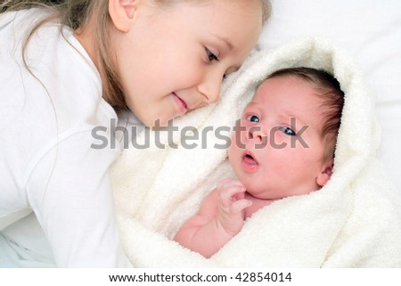 loving sister with little brother - stock photo