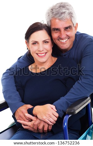 loving supportive husband hugging disabled wife isolated on white - stock photo