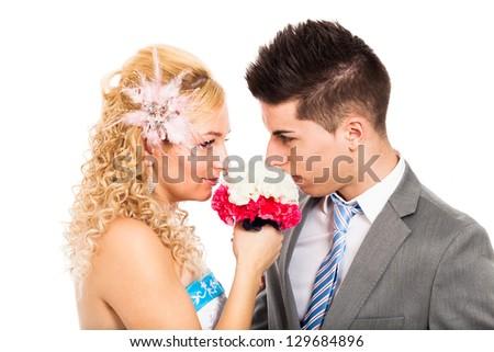 Loving wedding couple holding flower, isolated on white background. - stock photo