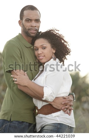 Loving young African American couple outside - stock photo