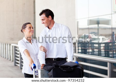 loving young couple at airport - stock photo