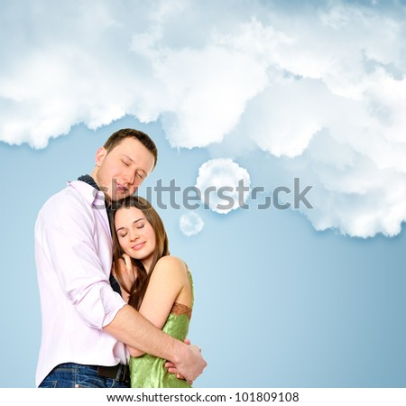 Loving young couple embracing. Blank cloud with their thoughts for your text