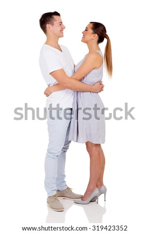 loving young couple looking at each other isolated on white - stock photo