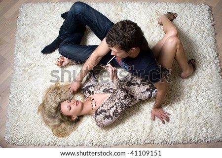 Loving young couple on the white carpet - stock photo