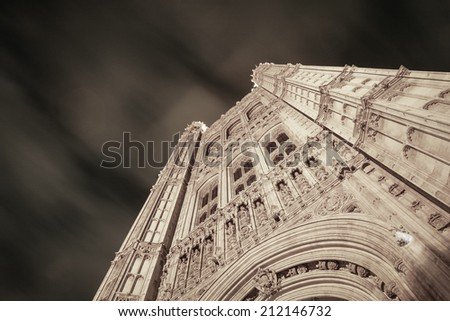 Low angle, abstract view up Victoria Tower, the tallest building within the UK seat of government, The Houses of Parliament in Westminster, London. - stock photo