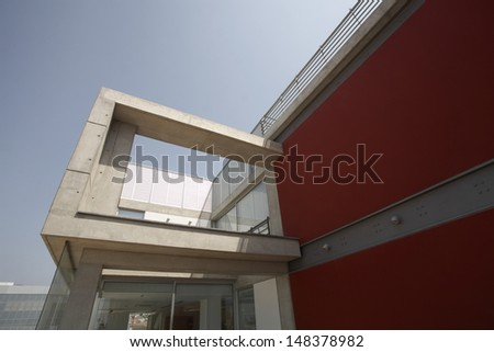 Low angle exterior of modern apartment building - stock photo