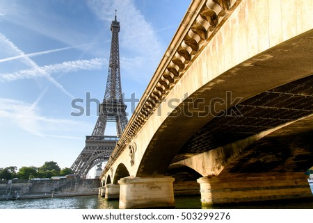 Low angle from the bridge in front of Eiffel tower, Paris, France.