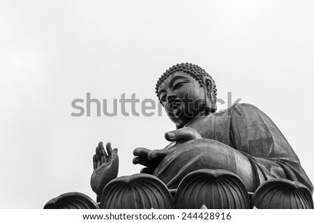 Low angle of a giant bronze buddha statue. Taken in Lantau Island, Hong Kong, China. - stock photo