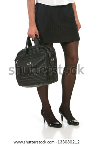 low angle of woman with beautiful legs holding briefcase. Shot against white background. - stock photo