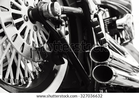Low angle photograph of motorcycle.