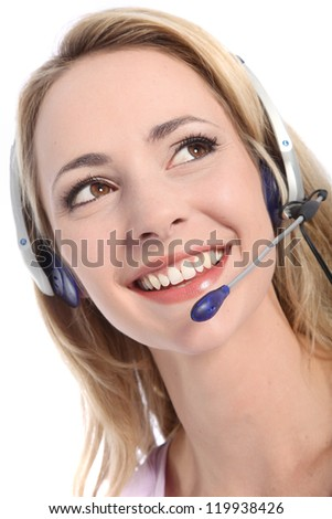 Low angle portrait of the head of a beautiful smiling friendly receptionist wearing a headset isolated on white