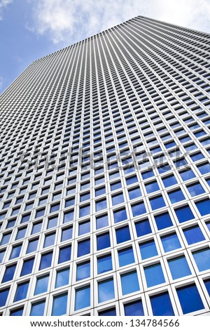 Low angle shot of an impressive skyscraper. - stock photo