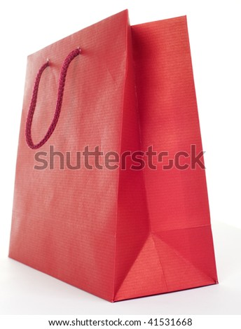 Low angle shot of red present bag on white background - stock photo