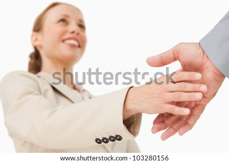 Low angle-shot of shake hands against white background - stock photo