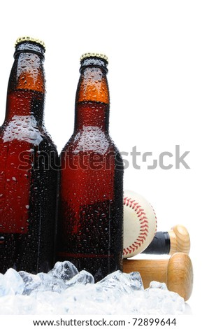 Low angle shot of two brown beer bottles with condensation and ice. Two Baseball bat handles and baseball are tucked in behind the bottles. Vertical format over a white background - stock photo