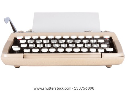 Low angle shot of typewriter with a sheet of paper isolated on a white background with clipping path
