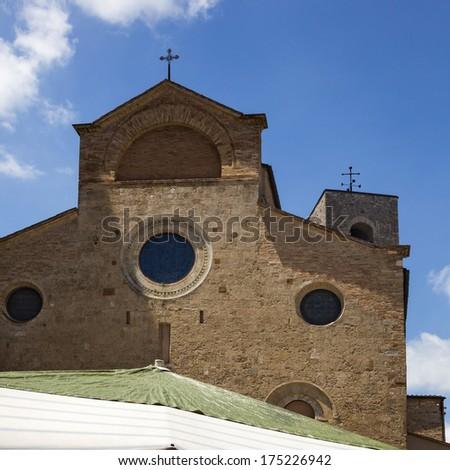 Low angle view of a church, Collegiate Church of San Gimignano, Piazza Del Duomo, San Gimignano, Siena, Siena Province, Tuscany, Italy - stock photo