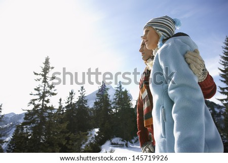Low angle view of a couple looking at view against sky - stock photo