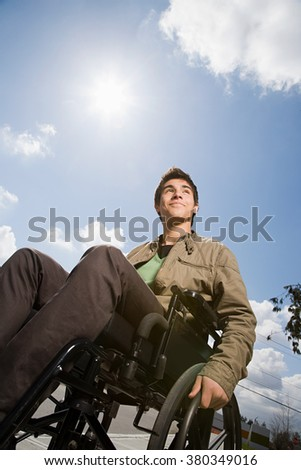 Low angle view of a disabled teenage boy - stock photo