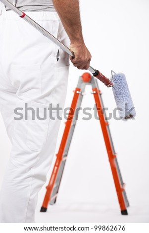 Low angle view of a painter with ladder