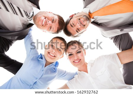 Low Angle View Of Businesspeople Making Huddle - stock photo
