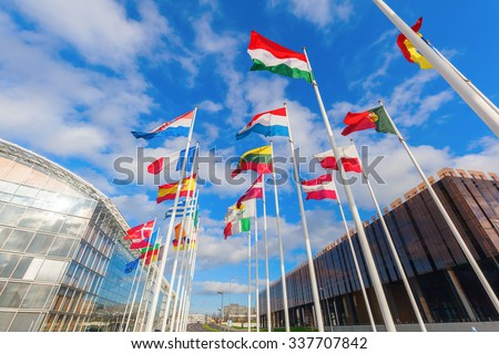 low angle view of European flags in the European district on the Kirchberg Plateau, Luxembourg - stock photo