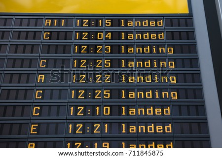 Low angle view of flight information board in airport