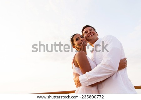 low angle view of happy young couple hugging