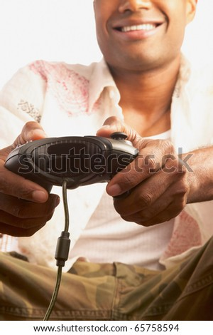 Low angle view of man playing video game - stock photo