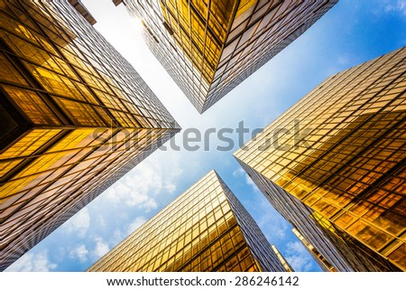 low angle view of modern skyscraper exterior and sky in modern city - stock photo