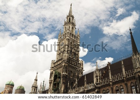 Low angle view of old town hall clock tower in Munich, Bavaria, Germany.